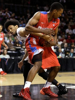 Saint Joseph's DeAndre Bembry, left, tries to grab the ball from Dayton's Dyshawn Pierre.