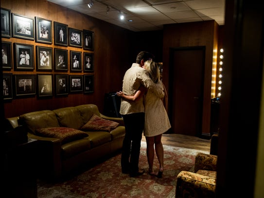 Following his performance, Charles Esten embraces his