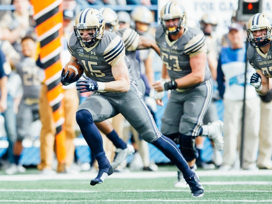 Troy Andersen of Montana State looks for running room
