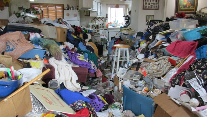 """The walkway from what is presumably the living room to the kitchen and dining room in the home of an Oregon couple that is being featured on a Jan. 24 episode of """"Hoarders"""" on A&E."""