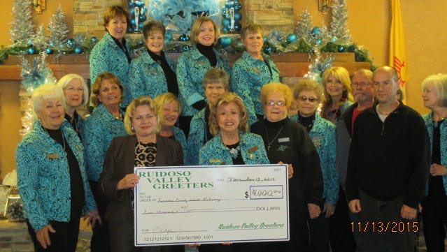 The Ruidoso Valley Greeters presented Lincoln County Adult Literacy (LCAL) a check for $4,000 during the Christmas Jubilee Nov.  Deborah Abingdon accepted the check from Greeter, Sylvia Ware.