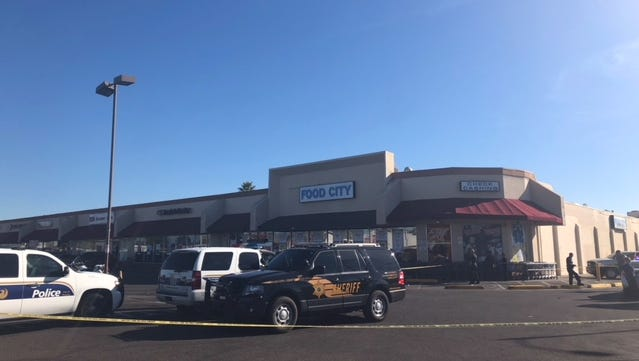 Police investigated a shooting outside Food City near McDowell Road and 32nd Street in Phoenix on Dec. 22, 2017.