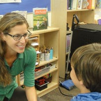 Teacher Anna Howell engages a student in Lincoln.