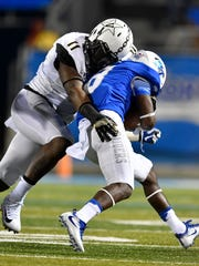 "Vanderbilt linebacker Charles Wright (11) stops Middle Tennessee wide receiver Ty Lee (8) during the second half of an NCAA college football game at Johnny ""Red"" Floyd Stadium in Murfreesboro, Tenn., Saturday, Sept. 2, 2017."