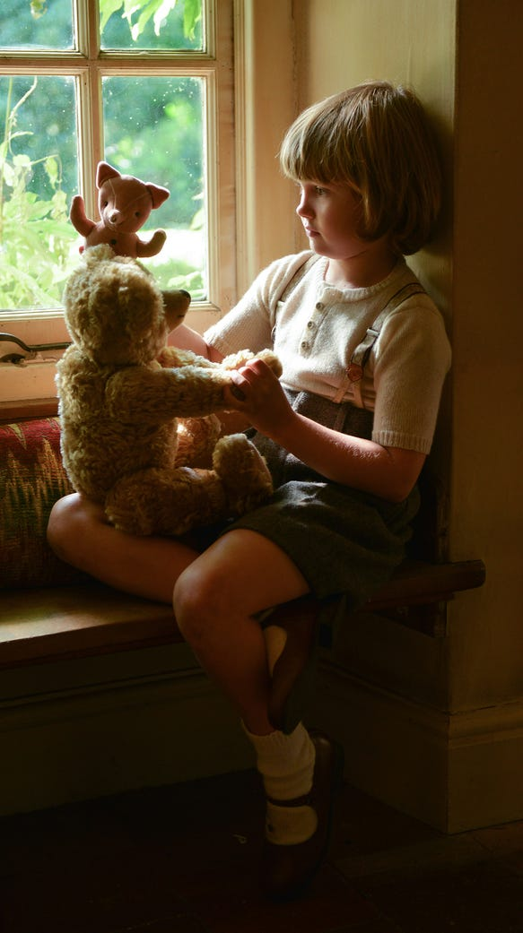 Christopher Robin (Will Tilston) and the stuffed toys