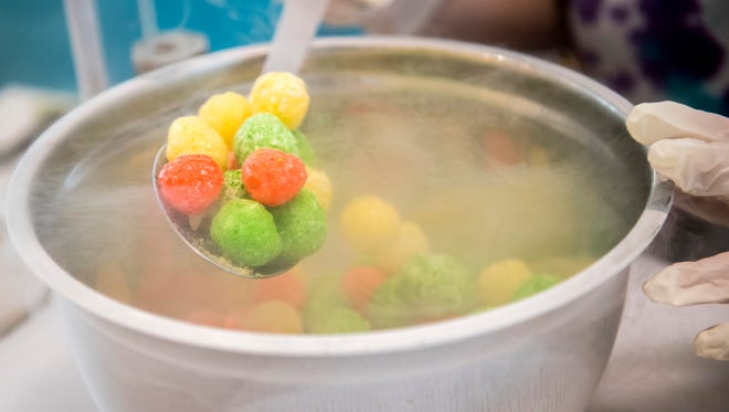 Dragon's Breath dessert is prepared at the stand inside West Town Mall in Knoxville on Wednesday, April 4, 2018. Dragon's Breath treats are made from cereal balls mixed with liquid nitrogen that, when eaten, will cause the diner to breathe like a dragon.