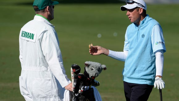 Jim Herman with caddie Matthew Achatz at the practice tee during a practice round prior to the 2016 The Masters golf tournament at Augusta National Golf Club on April 6.