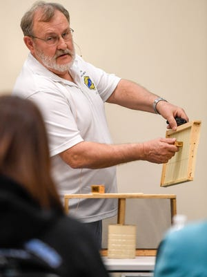 Larry Stone, president of the Audubon Beekeepers Association, shows where to place the queen bee while leading a discussion on how to unpack bees that have been shipped at the 12th annual Audubon Beekeepers Association Bee School Saturday, March 4, 2017.