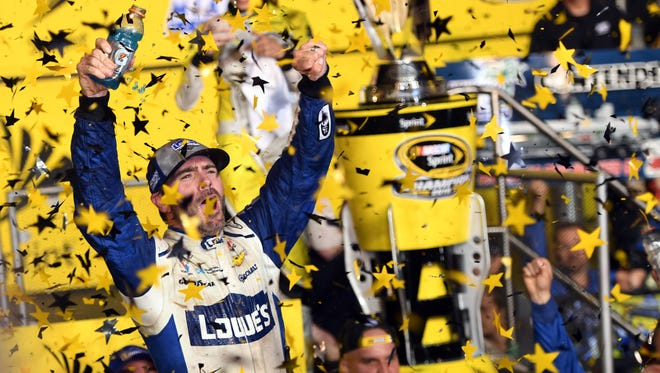 NASCAR Sprint Cup Series driver Jimmie Johnson (48) celebrates after winning the NASCAR Sprint Cup Championship after the Ford Ecoboost 400 at Homestead-Miami Speedway, Nov. 20, 2016.