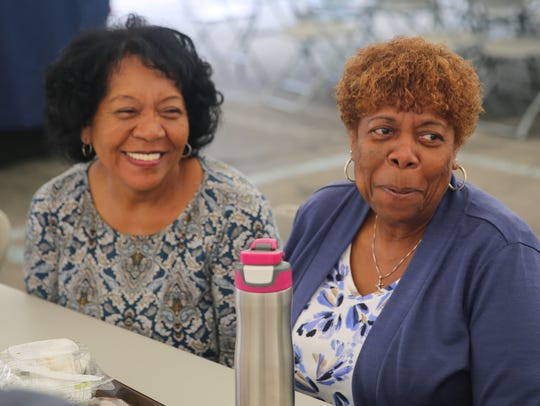 Mary Parker (right) and Ivey Samake (left) listen to
