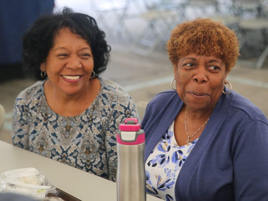 Mary Parker (right) and Ivey Samake (left) listen to their friends at the table on Thursday. They both said they like trying the food of other cultures.