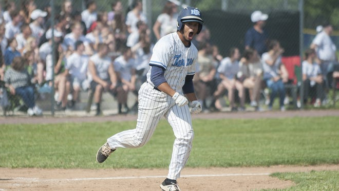 Highland's Dylan Maria reacts after hitting a home run last season.