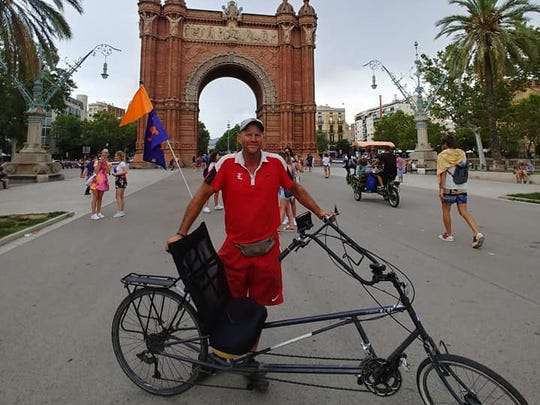 Leon tennis coach Kevin Record in Barcelona, Spain, after completing a bike trip from Oslo, Norway.
