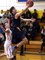 Pequannock junior David Jachera goes up for two points in front of Butler senior Brendan Glock in a NJAC-Independence game Wednesday.