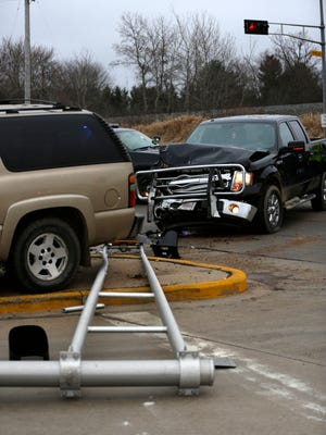 A Ford F-150 and Chevrolet Suburban crashed into a traffic light on Veteran's Parkway at the intersection of McMillian Street in Marshfield. At least one person was hospitalized.