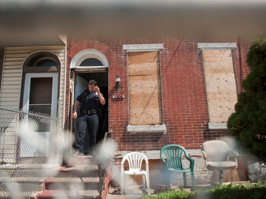 Camden County Police Officer Hector Ramirez clears an abandoned house in Camden.  Camden County Police Chief Scott Thomson has indicated his officers are pushing the violence out of the streets and that most slaying are happening indoors or in cars.   09.04.15
