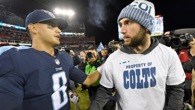 Titans quarterback Marcus Mariota (8) shakes hands with injured Colts quarterback Andrew Luck (12) after the Titans' win at Nissan Stadium Monday, Oct. 16, 2017 in Nashville, Tenn.