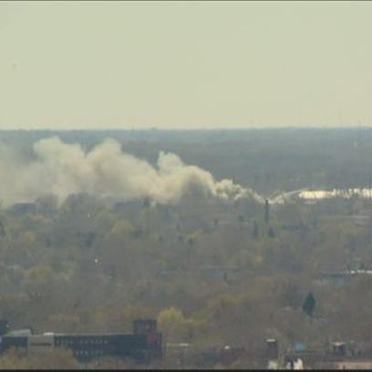 April 28, 2015: Thick smoke can be seen billowing from