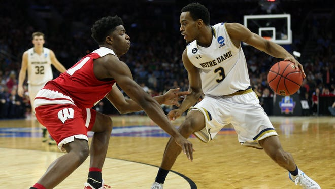 Mar 25, 2016; Philadelphia, PA, USA; Notre Dame Fighting Irish forward V.J. Beachem (3) drives against Wisconsin Badgers forward Khalil Iverson (21) during the second half in a semifinal game in the East regional of the NCAA Tournament at Wells Fargo Center. Mandatory Credit: Bill Streicher-USA TODAY Sports