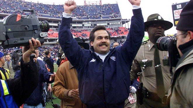 Former Titans coach Jeff Fisher celebrates the team's victory over the Bills after the AFC wild-card playoff game on Jan. 8, 2000.