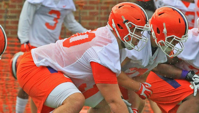 Offensive lineman Justin Falcinelli (50) prepares to snap the ball during practice on August 3, 2016 at the Clemson football practice facility.