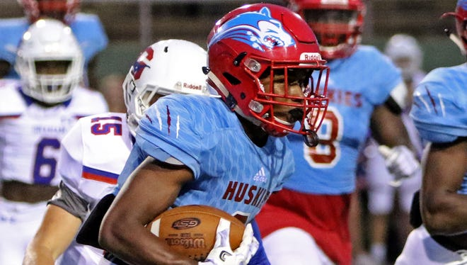Hirschi's Nathan Downing runs after catching the punt from Graham Thursday, Sept. 14, 2017, at Memorial Stadium. The Steers defeated the Huskies 42-35.
