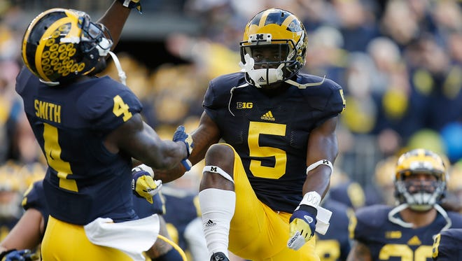 Jabrill Peppers (5) and De'Veon Smithof the Michigan Wolverines take the field prior to playing the Rutgers Scarlet Knights on Nov. 7, 2015, at Michigan Stadium in Ann Arbor.