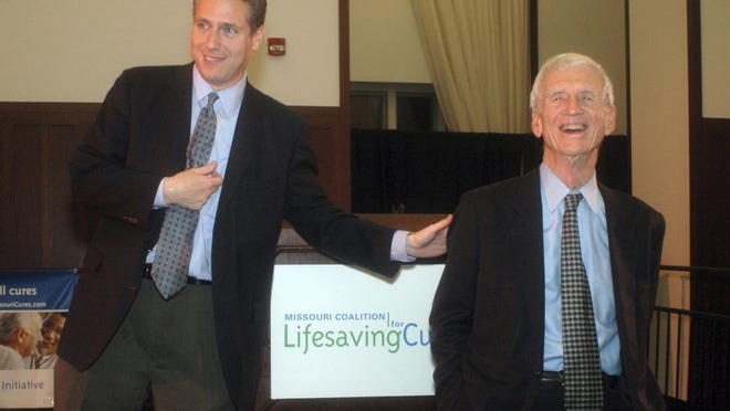 Donn Rubin, chairman of Missouri Coalition for Lifesaving Cures, left, thanks Washington University Chancellor Emeritus William Danforth in 2006 after learning Missouri voters narrowly approved a proposed state constitutional amendment to protect embryonic stem cell research. Danforth died Wednesday at his home in Ladue.