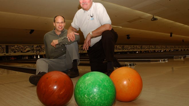 Russ Hoinke (left) and his father Erv Hoinke in their bowling alley. For use with Erardi story on the duo and their annual Thanksgiving Day tournament. Monday November 19, 2001. Cincinnati Enquirer/Michael E. Keating mek