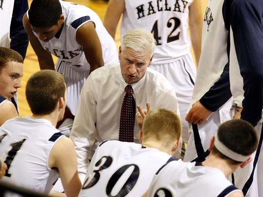 Maclay's coach Mike McGrotha talks to his team during a second half time out as West Gadsden downs Maclay 59-41 in the 2011 Class 2A regional quarterfinals.