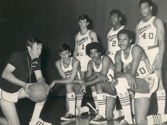 Coach Paul Hatcher poses with the 1971 seniors from his Lee High School basketball team.