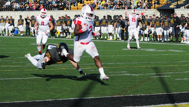 Olivet College running back Damoria Lilly runs for a touchdown against Adrian College on Saturday in Adrian.