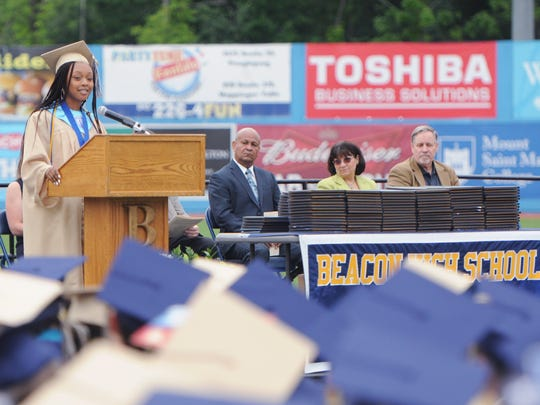 Valedictorian Phesheya Nxumalo addresses her classmates, guests and staff during Beacon High School's commencement ceremony at Dutchess Stadium on Saturday.