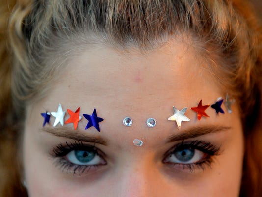 With a little help from Elmer's stick glue, Red Lion sophomore Sarah Cimino, 15, applied red, white and blue stickers to her forehead on for Red Lion's annual fireworks show.