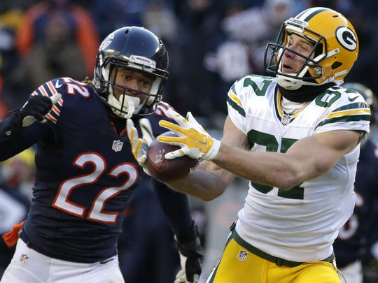 Packers wide receiver Jordy Nelson reels in 60-yard pass from Aaron Rodgers in front of Bears cornerback Cre'von LeBlanc to set up the winning field goal.