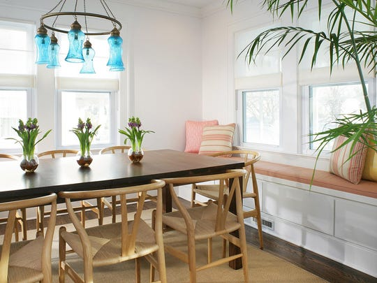 The window seat in this small dining room adds much-needed seating and additional storage.