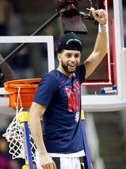Gonzaga Bulldogs guard Josh Perkins cuts down the net