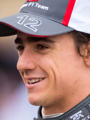 Nov 16, 2013; Austin, TX, USA; Formula One driver Esteban Gutierrez (12) is interviewed after placing tenth during qualifying for the United States Grand Prix at Circuit of the Americas.