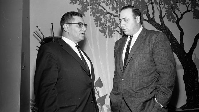 New Green Bay Packers coach Vince Lombardi, left, talks with scouting director Jack Vainisi during a luncheon introducing Lombardi at the Northland Hotel in downtown Green Bay on Feb. 3, 1959. Press-Gazette archives