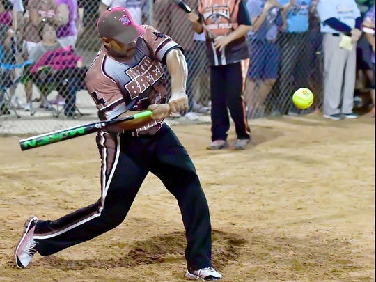 Perry Gallow, displaying his powerful swing, will be inducted into the USSSA State Softball Hall of Fame on Saturday in Lafayette.
