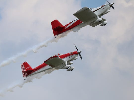 RV-8 Redline Airshows perform choreographed aerobatic stunts Wings and Warbirds Over Port Clinton on Saturday.