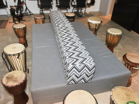 Several drums are set up around a table at DommLife,