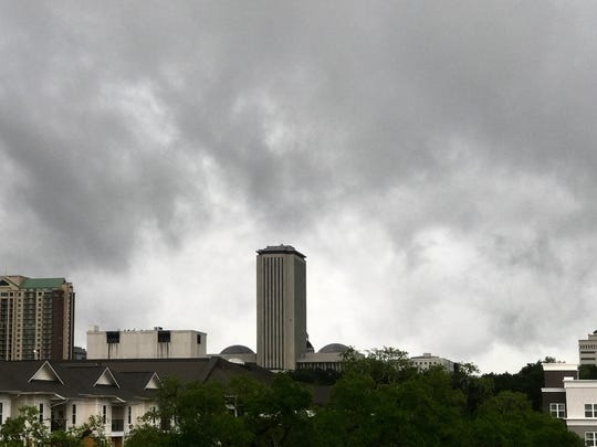 Dark storm clouds hang low over the Tallahassee skyline.
