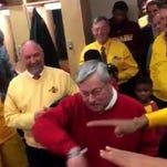 Iowa Gov. Terry Branstad does the Dab celebration in the Iowa State men's basketball team's locker room on Monday night.