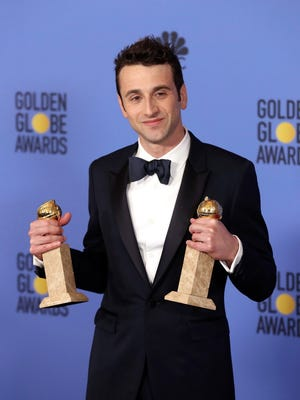 "Composer Justin Hurwitz holds the awards for Best Original Score and Best Original Song (for ""City of Stars"") for 'La La Land.' The musical broke the record for the most Golden Globes wins for a motion picture."