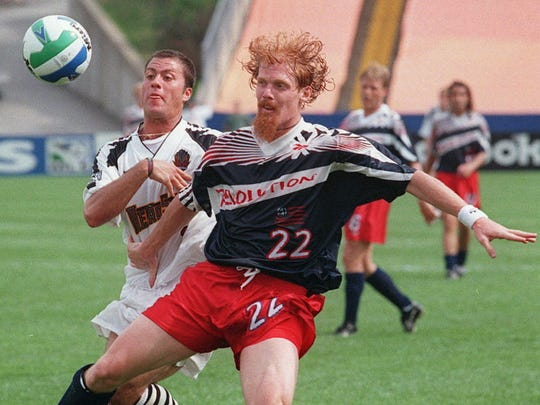Alexi Lalas playing for the New England Revolution
