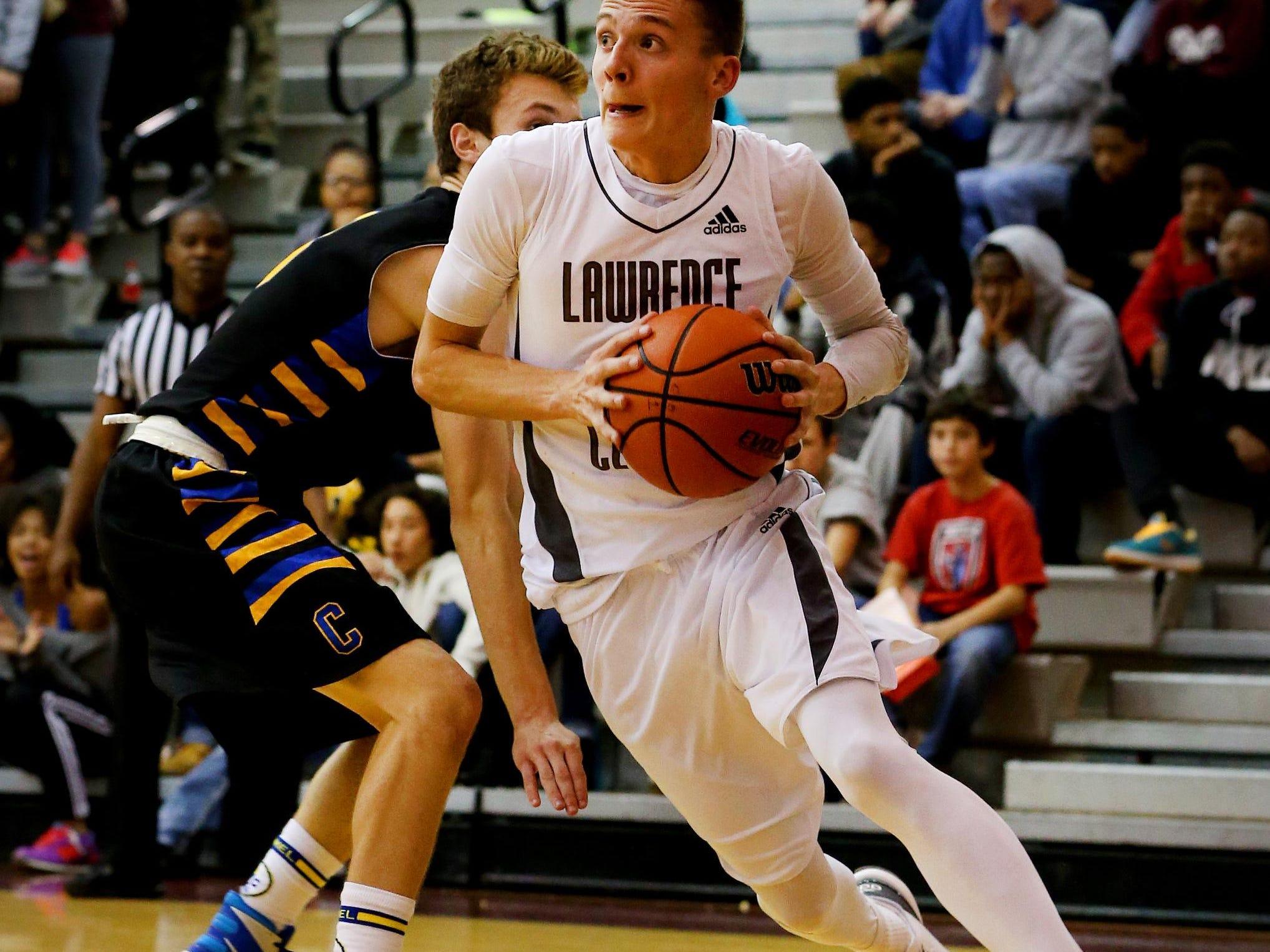 Lawrence Central's Kyle Guy (24) drives the baseline against Carmel on Dec. 4, 2015.