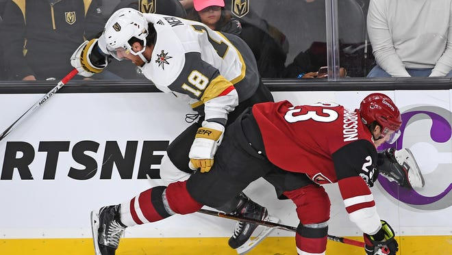 Arizona Coyotes defenseman Oliver Ekman-Larsson (23) checks Vegas Golden Knights left wing James Neal (18) into the boards during the first period of play at T-Mobile Arena.