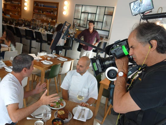 "A film crew records a scene from the documentary, ""In"