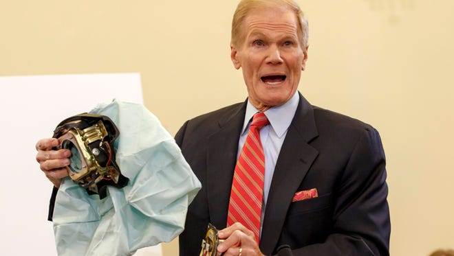 U.S. Senate Commerce Committee member Sen. Bill Nelson, D-Fla., in November 2014 displays a defective air bag made by Takata of Japan that has been linked to multiple deaths and injuries in the USA.